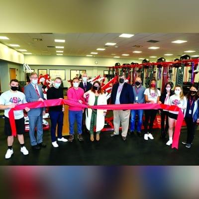 Senator Gaughran, Legislator Lafazan, Syosset Board of Education members, Superintendent of Schools Dr. Tom Rogers and Syosset High School students cut the ribbon at the new Fitness Center.