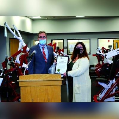 Senator Jim Gaughran presents Board of Education President Tracy Frankel with a proclamation.